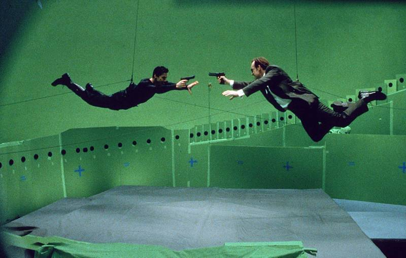 Keanu Reeves and Hugo Weaving on the set of The Matrix. Courtesy Warner Bros.