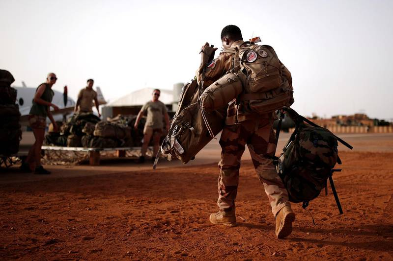 FILE PHOTO: A French soldier leaves with his backpack at the Operational Desert Platform Camp (PfOD) during the Operation Barkhane in Gao, Mali, August 1, 2019. Picture taken August 1, 2019. REUTERS/Benoit Tessier/File Photo