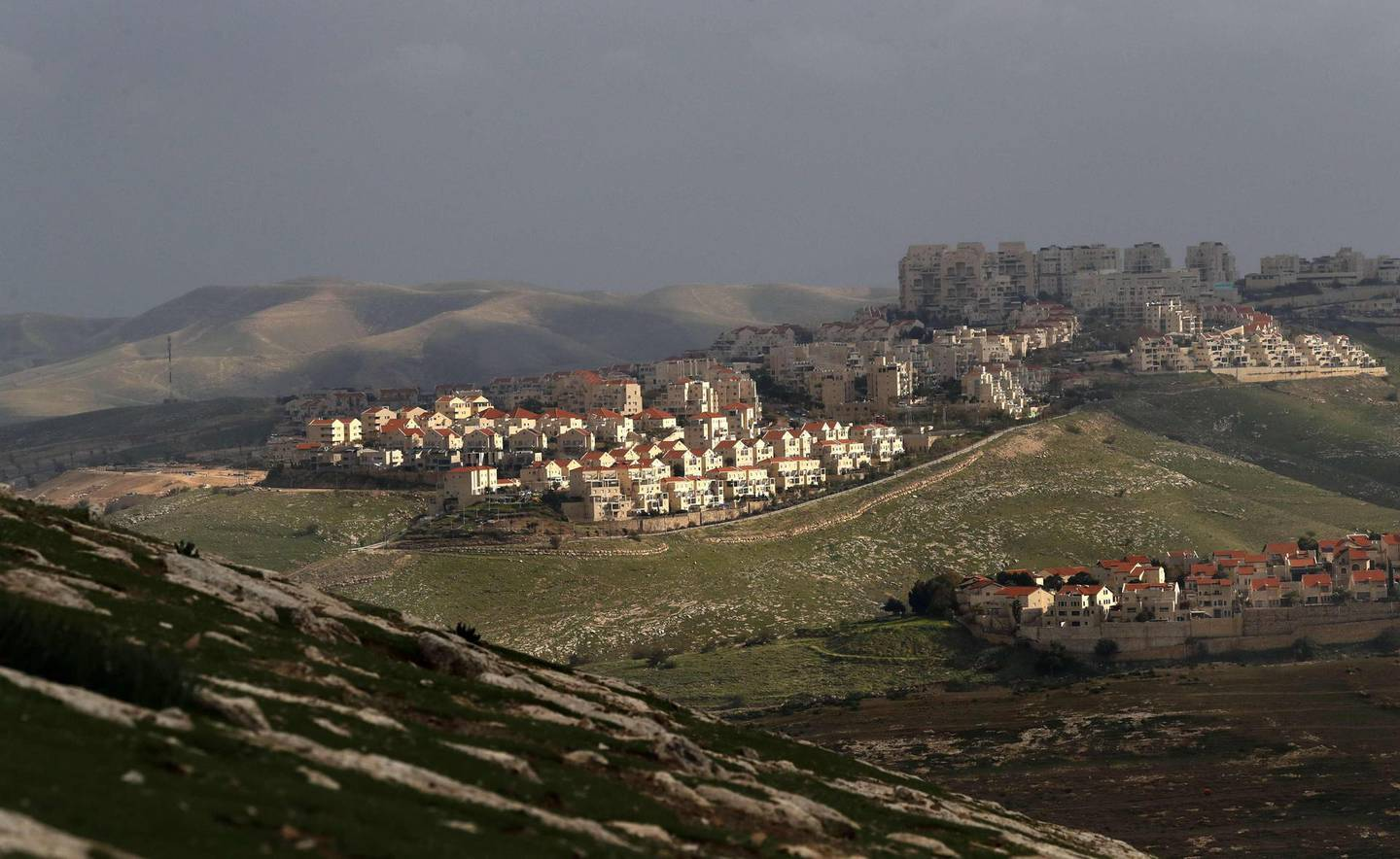 """A picture taken from the E1 corridor, a super-sensitive area of the occupied West Bank, shows Israeli settlement of Maale Adumin in the background on February 25, 2020. Netanyahu pledged to build 3,500 new settler homes in a super-sensitive area of the occupied West Bank, just a week before a tight general election. """"I gave immediate instructions for a permit to deposit (plans) for the construction of 3,500 units in E1,"""" Netanyahu said. / AFP / AHMAD GHARABLI"""