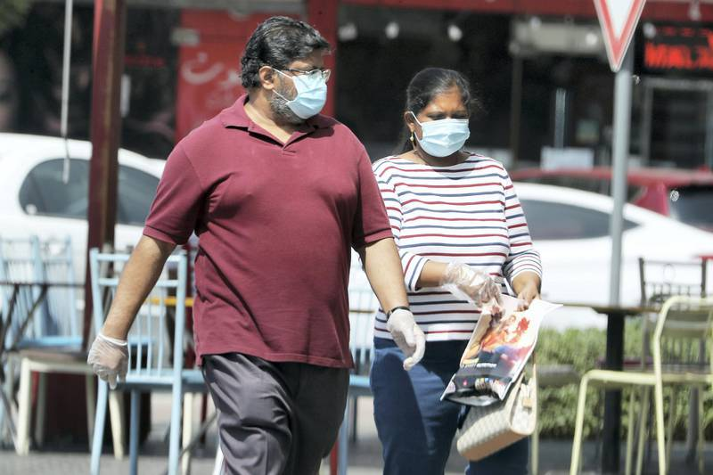 DUBAI, UNITED ARAB EMIRATES , October 3 – 2020 :- People wearing protective face mask and gloves as a preventive measure against the spread of coronavirus in Al Karama area in Dubai. (Pawan Singh / The National) For News/Stock/Online.