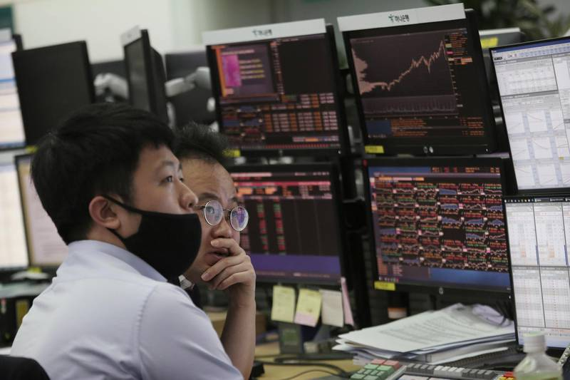 Currency traders watch monitors at the foreign exchange dealing room of the KEB Hana Bank headquarters in Seoul, South Korea, Tuesday, March 10, 2020. Asian stock markets are taking a breather from recent declines. (AP Photo/Ahn Young-joon)