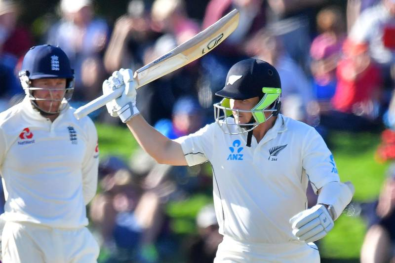 New Zealand's BJ Watling (R) celebrates 50 runs during day two of the second cricket Test match between New Zealand and England at Hagley Oval in Christchurch on March 31, 2018. / AFP PHOTO / Marty MELVILLE