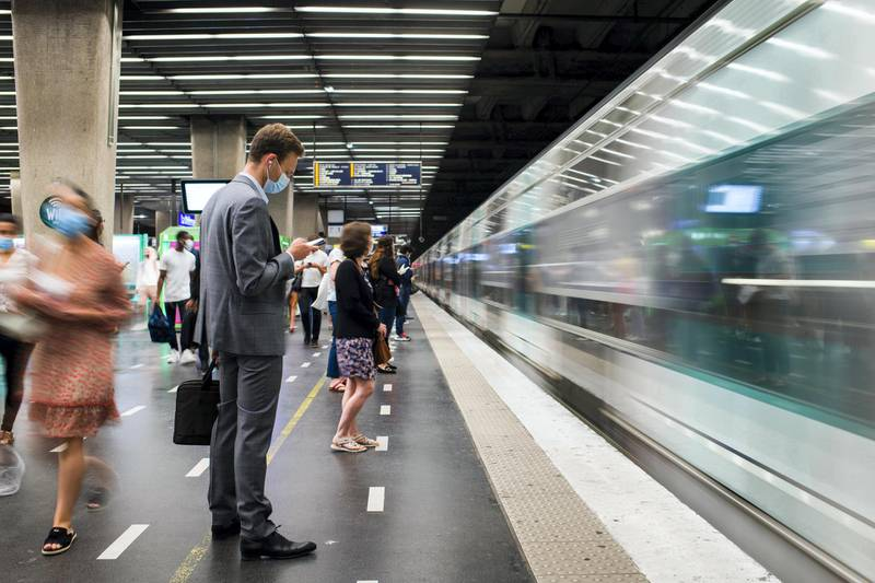 Morning commuters wearing protective face masks wait to board a train at the underground metro railway station in the La Defense business district in Paris, France, on Wednesday, June 9, 2021. Talks with labor unions are underway for a broad framework agreement on working from home, l'Obsreported, citing an interview with Labor MinisterElisabeth Borne. Photographer: Nathan Laine/Bloomberg
