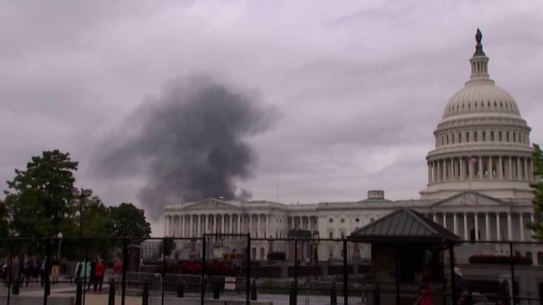 An image that illustrates this article Smoke appears to billow from US Capitol