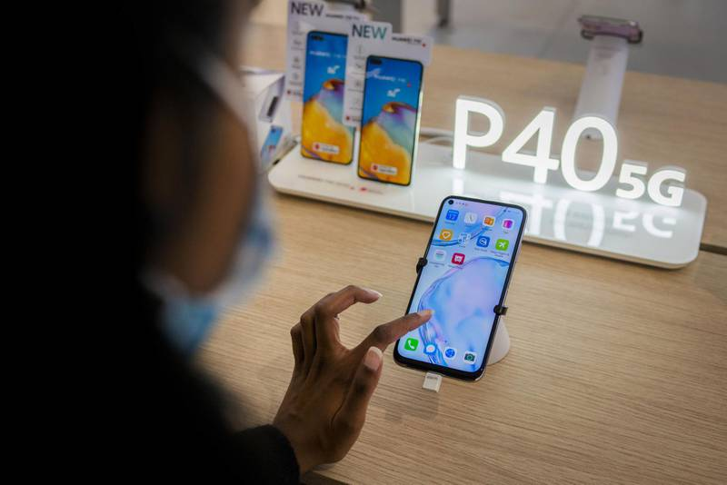 A customer tests a Huawei P40 5G-ready smartphone on display inside a Huawei Technologies Co. store at Menlyn Park Shopping Center in Pretoria, South Africa, on Wednesday, Aug. 12, 2020. Telecom company Rain said it has set up South Africa's first commercial fifth-generation mobile network in two large cities using equipment from China'sHuawei. Photographer: Waldo Swiegers/Bloomberg