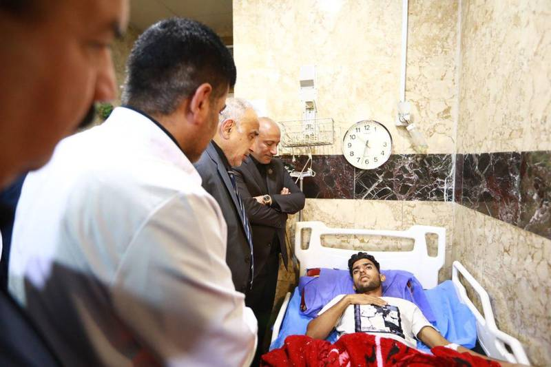 """A handout image released by the press office of Iraqi Prime Minister Adel Abdel Mahdi on September 10, 2019 shows him visiting an injured person at the hospital in Baghdad, Iraq, on September 10, 2019. More than 30 pilgrims were killed and dozens injured on September 10 ,2019 in a stampede at a major shrine in the Iraqi city of Karbala on the Shiite holy day of Ashura. - RESTRICTED TO EDITORIAL USE - MANDATORY CREDIT """"AFP PHOTO / IRAQI PRIME MINISTER'S PRESS OFFICE"""" - NO MARKETING - NO ADVERTISING CAMPAIGNS - DISTRIBUTED AS A SERVICE TO CLIENTS  / AFP / IRAQI PRIME MINISTER'S PRESS OFFICE / - / RESTRICTED TO EDITORIAL USE - MANDATORY CREDIT """"AFP PHOTO / IRAQI PRIME MINISTER'S PRESS OFFICE"""" - NO MARKETING - NO ADVERTISING CAMPAIGNS - DISTRIBUTED AS A SERVICE TO CLIENTS"""
