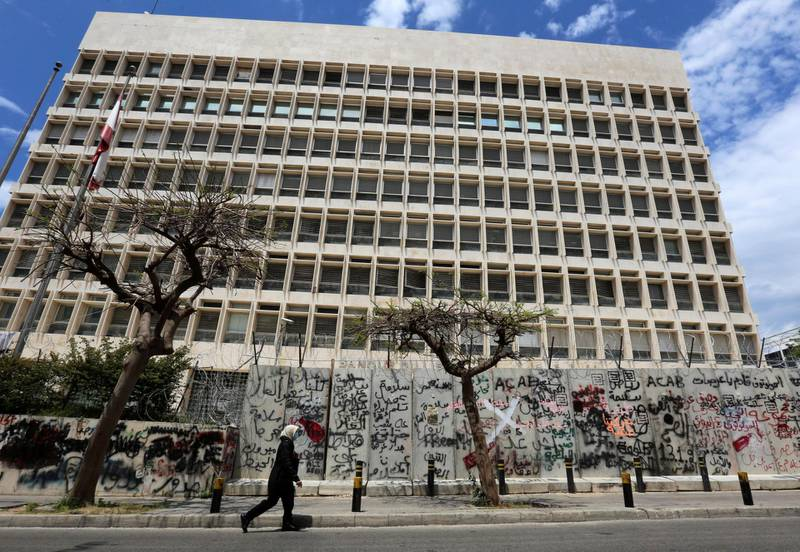 FILE PHOTO: A woman wearing a protective mask walks past Central Bank building as Lebanon extends a shutdown to curb the spread of the coronavirus disease (COVID-19) in Beirut, Lebanon, May 5, 2020. REUTERS/Aziz Taher/File Photo