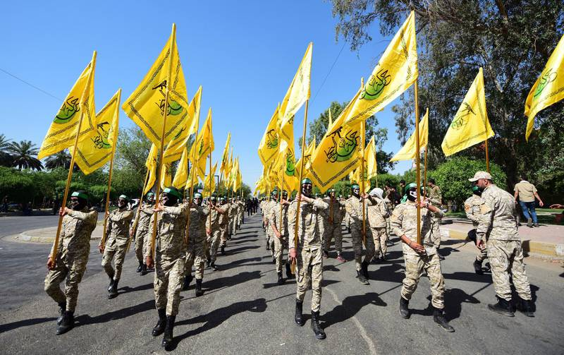 epa07614235 Fighters of Iraqi Shiite group Al-Nujaba'a movement carry their flags and march during an anti-Israel rally to mark a Jerusalem day, or Al-Quds day, in Baghdad, 31 May 2019. Al-Quds Day, an annual day of protest decreed in 1979 by the late Iranian ruler Ayatollah Khomeini, is celebrated in a move to express support for the Palestinian people and their resistance against Israel.  EPA-EFE/MURTAJA LATEEF