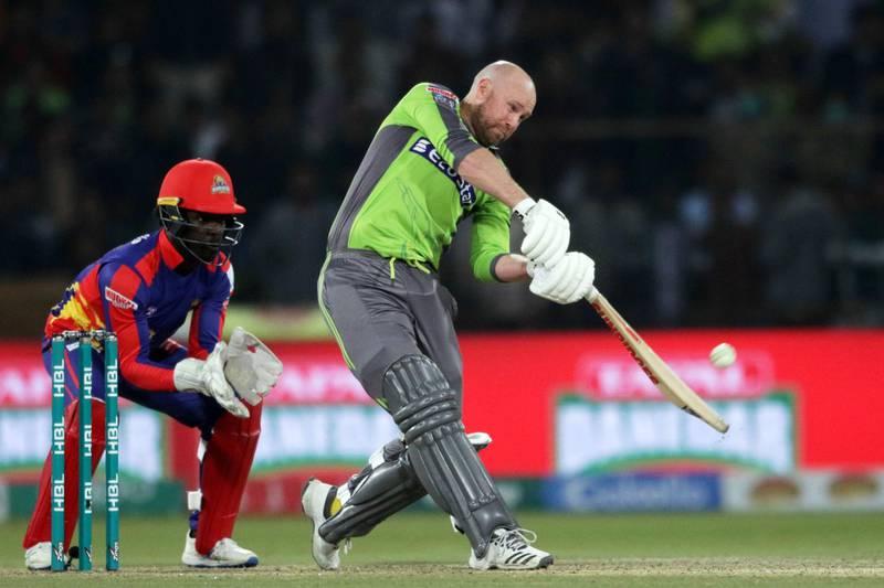 epa08279536 Ben Dunk of Lahore Qalandars plays a shot during Pakistan Super League (PSL) T20 series match, against Karachi Kings, in Lahore, Pakistan, 08 March 2020.  EPA/RAHAT DAR