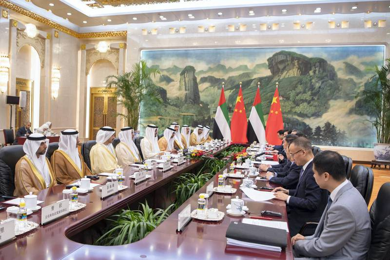 BEIJING, CHINA - July 22, 2019: HH Sheikh Mohamed bin Zayed Al Nahyan, Crown Prince of Abu Dhabi and Deputy Supreme Commander of the UAE Armed Forces (5th L), meets with with HE Li Keqiang, Premier of the State Council of China (not shown), at the Great Hall of the People. Seen with HE Suhail bin Mohamed Faraj Faris Al Mazrouei, UAE Minister of Energy (L), HE Ali Mohamed Hammad Al Shamsi, Deputy Secretary-General of the UAE Supreme National Security Council (2nd L), HH Sheikh Abdullah bin Zayed Al Nahyan UAE Minister of Foreign Affairs and International Cooperation (3rd L), HH Lt General Sheikh Saif bin Zayed Al Nahyan, UAE Deputy Prime Minister and Minister of Interior (4th L), HH Sheikh Hamed bin Zayed Al Nahyan, Chairman of the Crown Prince Court of Abu Dhabi and Abu Dhabi Executive Council Member (6th L), HE Khaldoon Khalifa Al Mubarak, CEO and Managing Director Mubadala, Chairman of the Abu Dhabi Executive Affairs Authority and Abu Dhabi Executive Council Member (7th L), HE Sultan bin Saeed Al Mansouri, UAE Minister of Economy (8th L), HE Dr Sultan Ahmed Al Jaber, UAE Minister of State, Chairman of Masdar and CEO of ADNOC Group (9th L) and HE Hussain Ibrahim Al Hammadi, UAE Minister of Education (R).  ( Saeed Al Neyadi / Ministry of Presidential Affairs ) ---