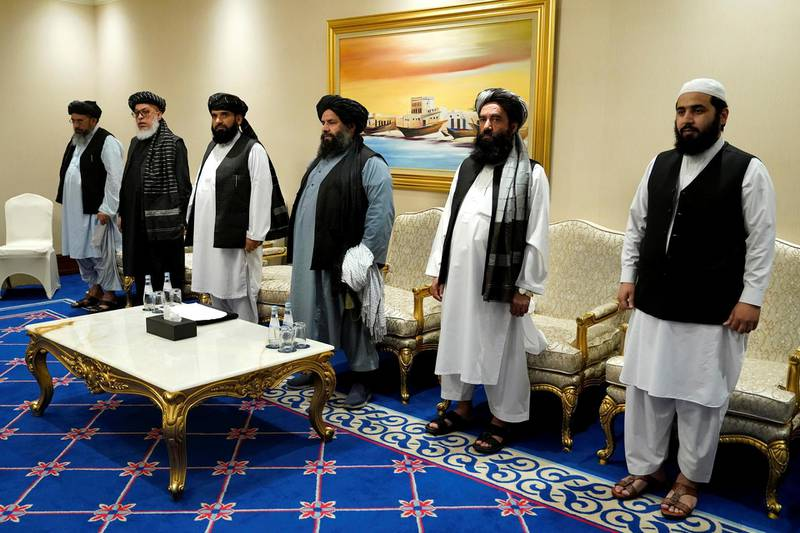 Members of the Taliban's peace negotiation team attend a meeting with U.S. Secretary of State Mike Pompeo, amid talks between the Taliban and the Afghan government, in Doha, Qatar November 21, 2020. Patrick Semansky/Pool via REUTERS