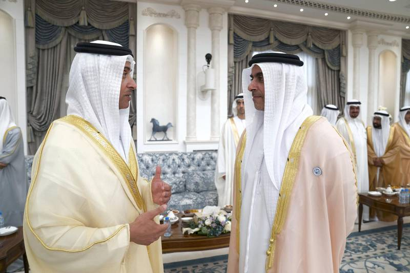 ABU DHABI, UNITED ARAB EMIRATES - August 21, 2018: HH Sheikh Hazza bin Zayed Al Nahyan, Vice Chairman of the Abu Dhabi Executive Council (L) and HH Lt General Sheikh Saif bin Zayed Al Nahyan, UAE Deputy Prime Minister and Minister of Interior (R) attend an Eid Al Adha reception at Mushrif Palace.  ( Mohamed Al Hammadi / Crown Prince Court - Abu Dhabi ) ---