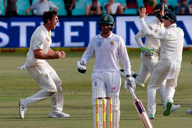 Australia's bowler Mitchell Marsh (L) celebrates taking the wicket of South Africa's batsman Aiden Markram during the fourth day of the first Test cricket match between South Africa and Australia at The Kingsmead Stadium in Durban on March 4, 2018. / AFP PHOTO / MARCO LONGARI