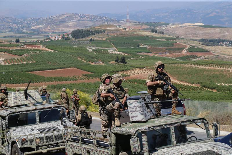 epa09201660 Lebanese army soldiers patrol Al Odaisseh area opposite the Al-Mutaleh Israeli settlement at the Lebanese border with Israel, 15 May 2021. People protested to support Palestinians following the past violence which has, according to local health authorities killed at least 139 people in Gaza and 7 in Israel.  EPA/NABIL MOUNZER