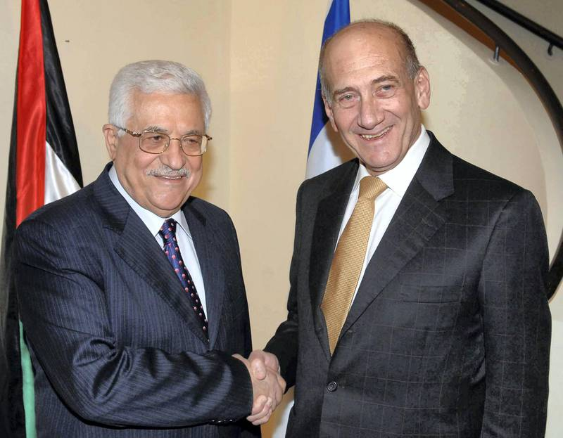 """Israel's Prime Minister Ehud Olmert (R) greets Palestinian President Mahmoud Abbas during their meeting in Jerusalem September 16, 2008, in this picture released by the Israeli Government Press Office (GPO). A spokesman for Olmert told reporters that the two had held """"serious"""" discussions in Jerusalem and would meet again after Abbas returns from a trip to the United States later this month. REUTERS/Moshe Milner/GPO/Handout (JERUSALEM).  FOR EDITORIAL USE ONLY. NOT FOR SALE FOR MARKETING OR ADVERTISING CAMPAIGNS. ISRAEL OUT. NO COMMERCIAL OR EDITORIAL SALES IN ISRAEL."""