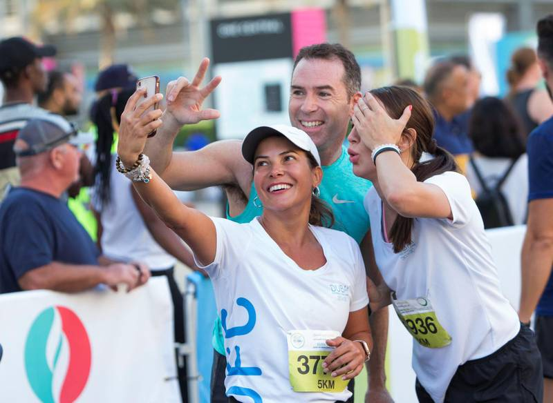 Dubai, United Arab Emirates - Participants at the finish line at the Dubai 30x30 Run at Sheikh Zayed Road.  Leslie Pableo for The National