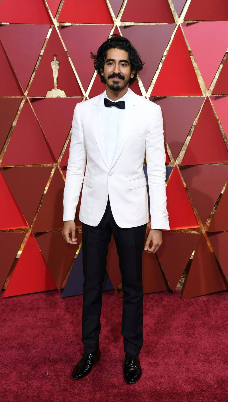 """Nominee for Best Supporting Actor """"Lion"""" Dev Patel arrives on the red carpet for the 89th Oscars on February 26, 2017 in Hollywood, California. (Photo by ANGELA WEISS / AFP)"""