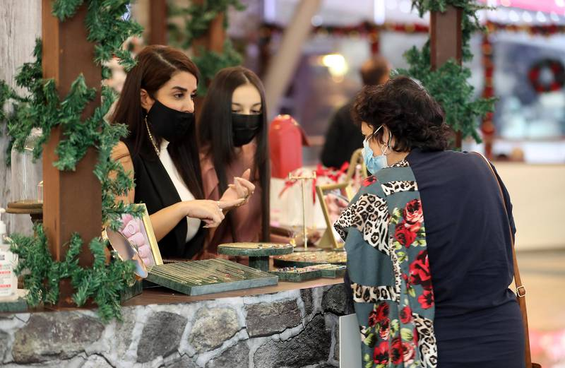 DUBAI , UNITED ARAB EMIRATES , November 26 – Visitors at the Winter Wonderland Festive Market at Mall of the Emirates in Dubai. ( Pawan Singh / The National ) For News/Online/Standalone/Instagram/Big Picture
