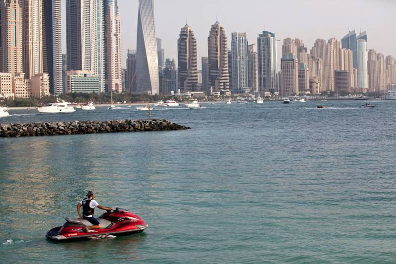 DUBAI, UNITED ARAB EMIRATES,  JUNE 06, 2013. General image of jet ski's. A rider prepares to set off from around the start of the trunk of The Palm Jumeirah. Jet Skiers are allowed to enter this area but are not allowed to enter The Palm and jet ski between the houses. Permission for photography was not obtained from the pictured people. (ANTONIE ROBERTSON / The National)