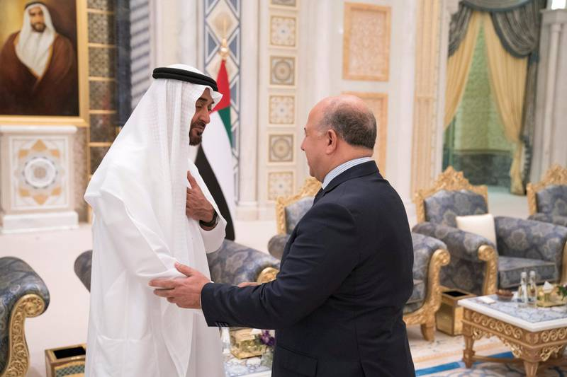 ABU DHABI, UNITED ARAB EMIRATES - May 20, 2018: HH Sheikh Mohamed bin Zayed Al Nahyan Crown Prince of Abu Dhabi Deputy Supreme Commander of the UAE Armed Forces (L), receives HE Osama Nafa'a, Ambassador of Hungary to the UAE (R), during an iftar reception at the Presidential Palace.   ( Hamad Al Kaabi / Crown Prince Court - Abu Dhabi ) ---