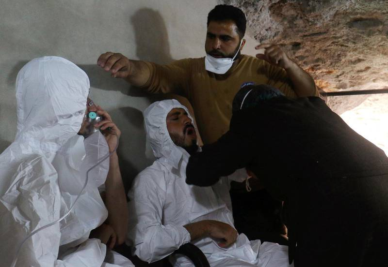A man breathes through an oxygen mask as another one receives treatments, after what rescue workers described as a suspected gas attack in the town of Khan Sheikhoun in rebel-held Idlib, Syria April 4, 2017. REUTERS/Ammar Abdullah - RC1B0D27C0B0