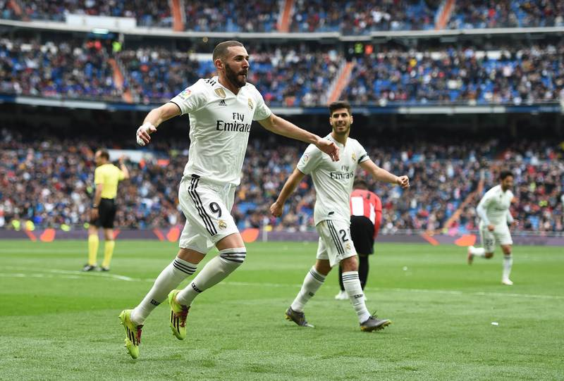 MADRID, SPAIN - APRIL 21: Karim Benzema of Real Madrid CF celebrates with Marco Asensio after scoring Real's second goal during the La Liga match between Real Madrid CF and Athletic Club at Estadio Santiago Bernabeu on April 21, 2019 in Madrid, Spain. (Photo by Denis Doyle/Getty Images)