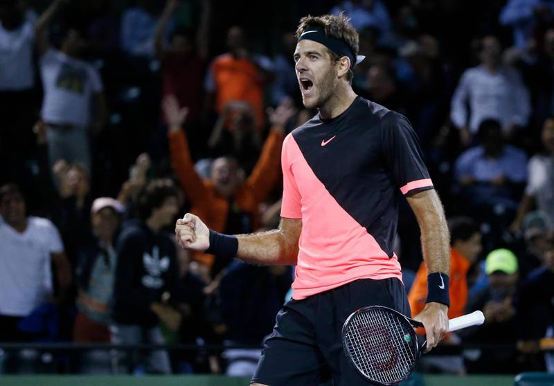 Juan Martin del Potro, of Argentina, celebrates after defeating Milos Raonic, of Canada, 5-7, 7-6 (1), 7-6 (3) in the quarterfinals of the Miami Open tennis tournament early Thursday, March 29, 2018, in Key Biscayne, Fla. (AP Photo/Wilfredo Lee)