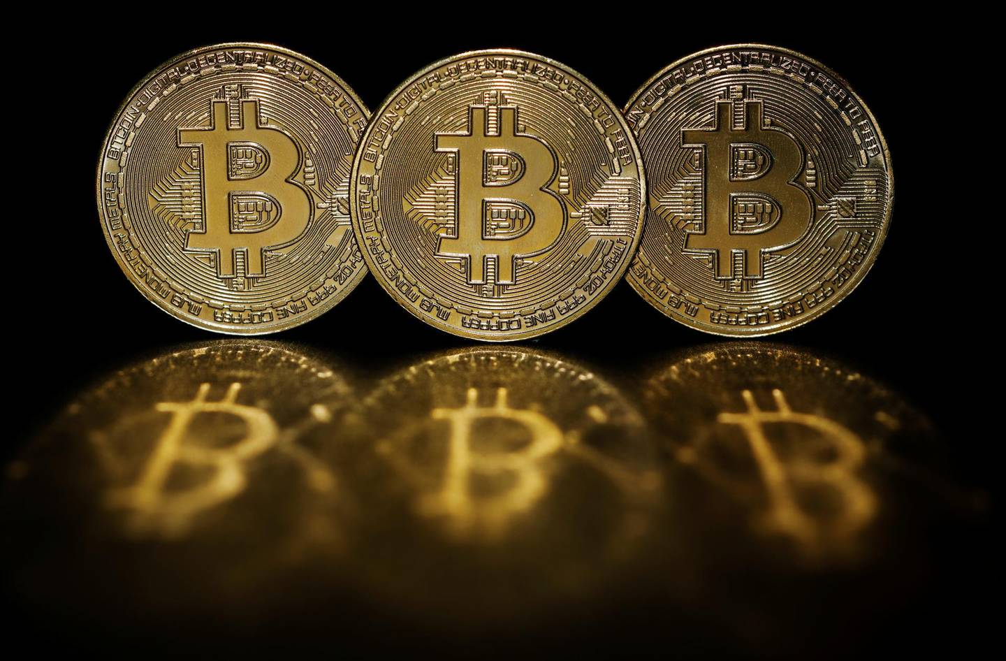 Representations of cryptocurrency Bitcoin are seen in this picture illustration taken June 7, 2021.   REUTERS/Edgar Su/Illustration