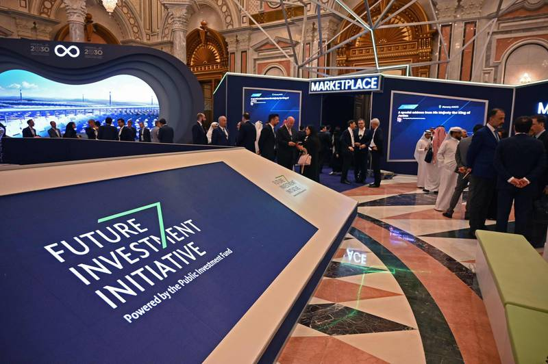 Delegates arrive at the King Abdulazziz Conference Centre in Saudi Arabia's capital Riyadh to attend the Future Investment Initiative (FII) forum on October 29, 2019. Top finance moguls and political leaders were expected at a Davos-style Saudi investment summit in stark contrast to last year when outrage over critic Jamal Khashoggi's murder sparked a mass boycott. Organisers say 300 speakers from over 30 countries, including American officials and heads of global banks and major sovereign wealth funds, are attending the three-day forum.   / AFP / FAYEZ NURELDINE