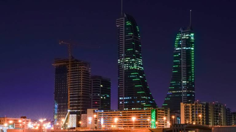 An image that illustrates this article Bahrain landmarks lit up in Saudi flag colours - in pictures