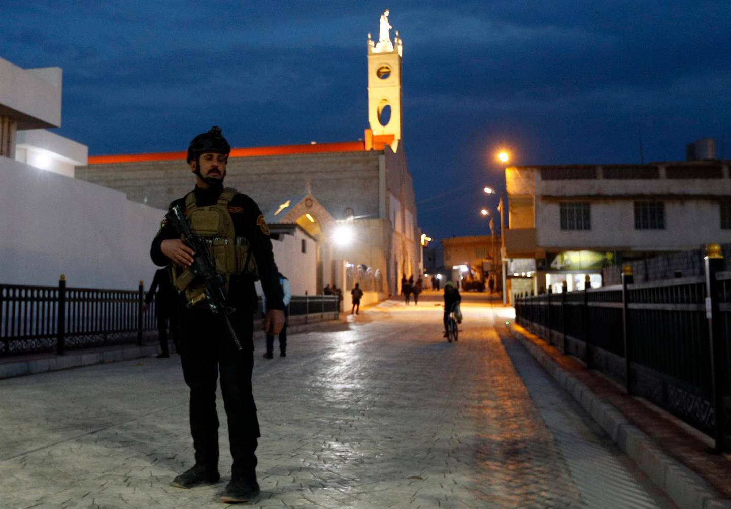 """An Iraqi army soldier stands patrol outside the Immaculate Conception Church during preparations for Pope Francis' upcoming trip to Iraq in Qaraqos, Iraq, Thursday, March. 4, 2021. The pope will visit the church of the """"Immaculate Conception"""" in Qaraqosh in northern Iraq, during his historic trip to the country this week. Damaged and charred during the IS reign of terror, the church's tragedy mirrored that of its Christian community which was devastated by the group. (AP Photo/Hadi Mizban)"""
