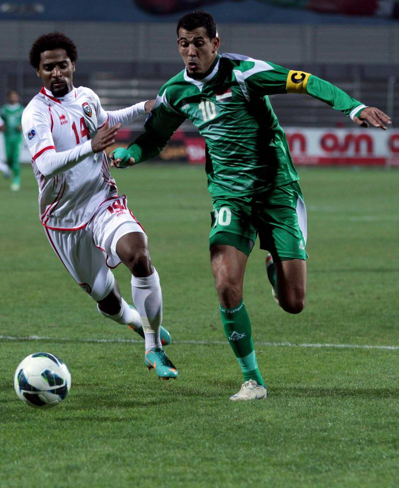 United Arab Emirates's Abdelaziz El-Mazni, left, fights for the ball with Iraq's Younus Mahmood, right, during the Gulf Cup final Friday, Jan. 18 , 2013, in Rifa, Bahrain. United Arab Emirates beat Iraq 2-1 in extra time on Friday to claim its second Gulf Cup title. (AP Photo/Hasan Jamali) *** Local Caption ***  Bahrain Gulf Cup.JPEG-03595.jpg
