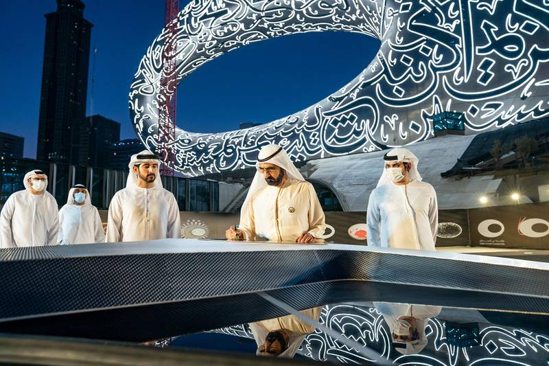 Sheikh Mohammed Bin Rashid, Vice-President and Prime Minister of the UAE and Ruler of Dubai, witnesses the installation of the final piece of façade of Museum of the Future. Seen with Sheikh Hamdan bin Mohammed bin Rashid Al Maktoum, Dubai Crown Prince and Chairman of The Executive Council of Dubai and Chairman of the Board of Trustees of Dubai Future Foundation; and Sheikh Maktoum bin Mohammed bin Rashid Al Maktoum, Deputy Ruler of Dubai. Courtesy Museum of the Future