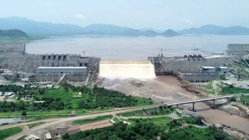 """This frame grab from a video obtained from the Ethiopian Public Broadcaster (EBC) on July 20 and July 21, 2020 and released on July 24, 2020 shows an aerial view of water levels at the Grand Ethiopian Renaissance Dam in Guba, Ethiopia, as Prime Minister Abiy Ahmed hails the """"historic"""" early filling of the reservoir on the Blue Nile River that has stoked tensions with downstream neighbours Egypt and Sudan. (Photo by - / Ethiopian Public Broadcaster (EBC) / AFP) / RESTRICTED TO EDITORIAL USE - MANDATORY CREDIT """"AFP PHOTO /Ethiopian Public Broadcaster (EBC) """" - NO MARKETING - NO ADVERTISING CAMPAIGNS - DISTRIBUTED AS A SERVICE TO CLIENTS"""