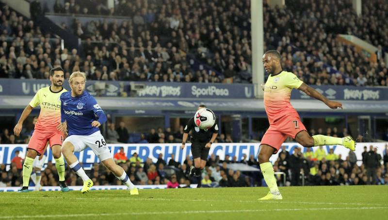 """Soccer Football - Premier League - Everton v Manchester City - Goodison Park, Liverpool, Britain - September 28, 2019  Manchester City's Raheem Sterling scores their third goal    Action Images via Reuters/Andrew Boyers  EDITORIAL USE ONLY. No use with unauthorized audio, video, data, fixture lists, club/league logos or """"live"""" services. Online in-match use limited to 75 images, no video emulation. No use in betting, games or single club/league/player publications.  Please contact your account representative for further details."""