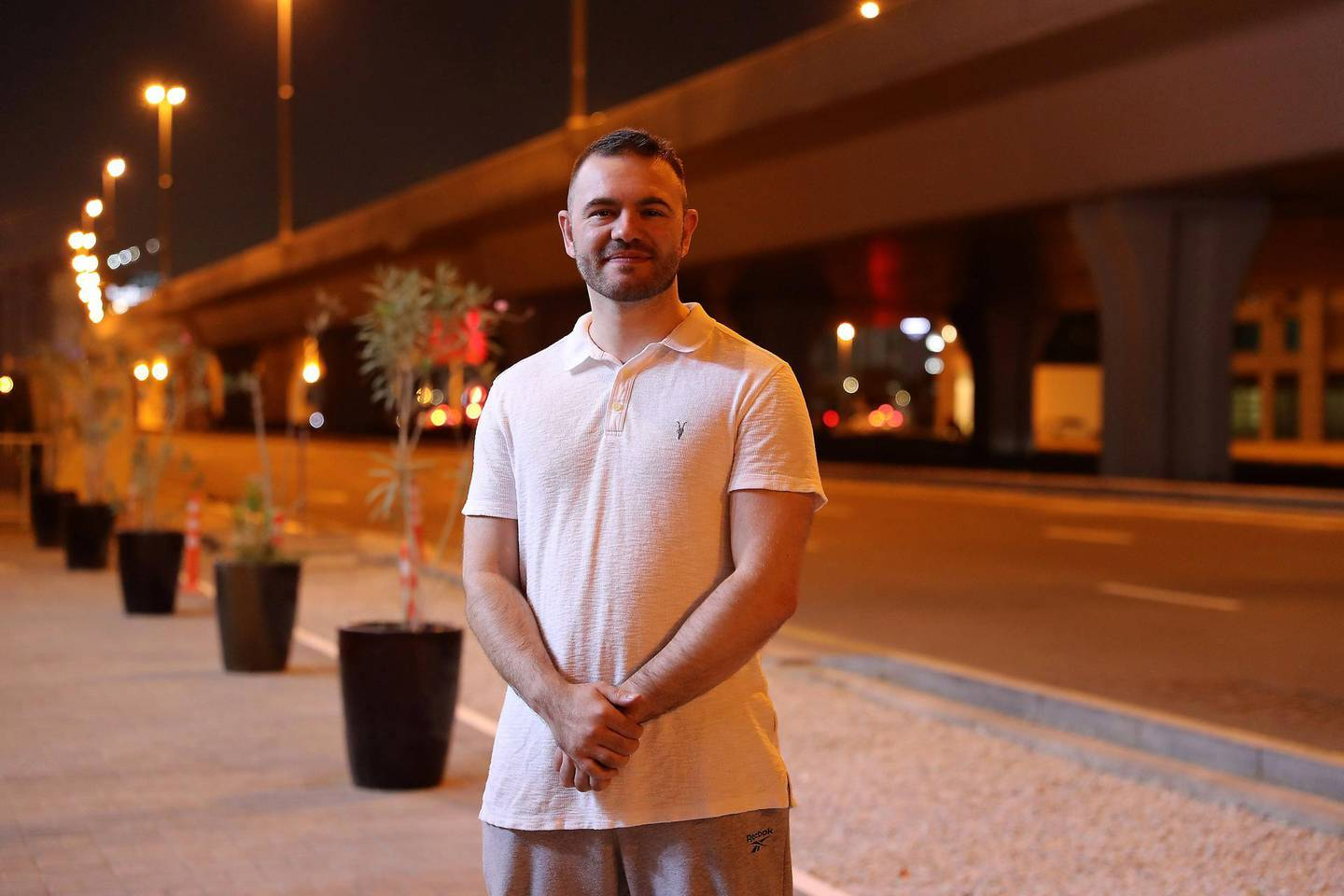 DUBAI, UNITED ARAB EMIRATES , November 17 – 2020 :- Ryan Maxwell outside his home in Business Bay area in Dubai. (Pawan Singh / The National) For Business. Story by Deepthi