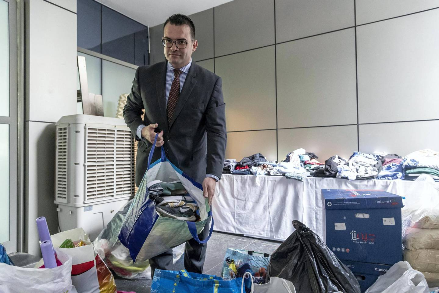DUBAI, UNITED ARAB EMIRATES. 14 MAY 2018. Zen Tower fire in the Marina. Hotel Manager Agusti Curto Calbet looks at goods donated by the public that are being collected at the Wyndham Hotel. (Photo: Antonie Robertson/The National) Journalist: Nicke Webster. Section: National.