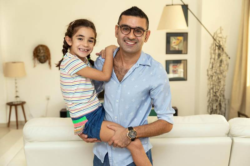 DUBAI, UNITED ARAB EMIRATES. 12 OCTOBER 2019. Tariq Bell and his daughter Eleanor. Tariq is one of the expats who did a stint in the UAE, left, and then returned. (Photo: Antonie Robertson/The National) Journalist: Suzanne Locke. Section: National.