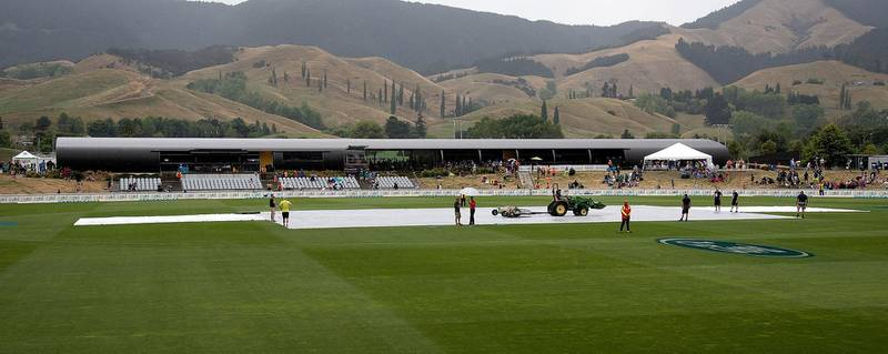 The covers lay on the field as the rain falls during the second one-day international cricket match between New Zealand and Pakistan at Saxton Oval in Nelson on January 9, 2018. (Photo by Marty MELVILLE / AFP)