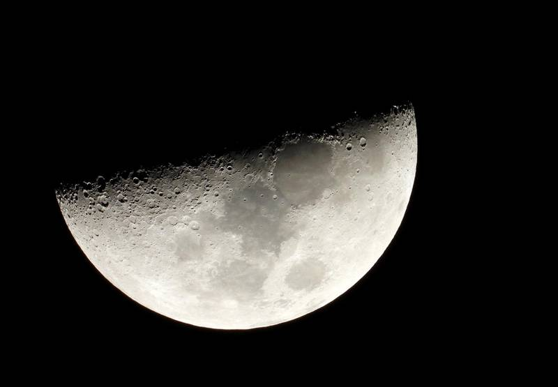FILE PHOTO: Moon is seen in the sky during the closest visible conjunction of Jupiter and Saturn in 400 years, in Tejeda, on the island of Gran Canaria, Spain December 21, 2020. REUTERS/Borja Suarez/File Photo