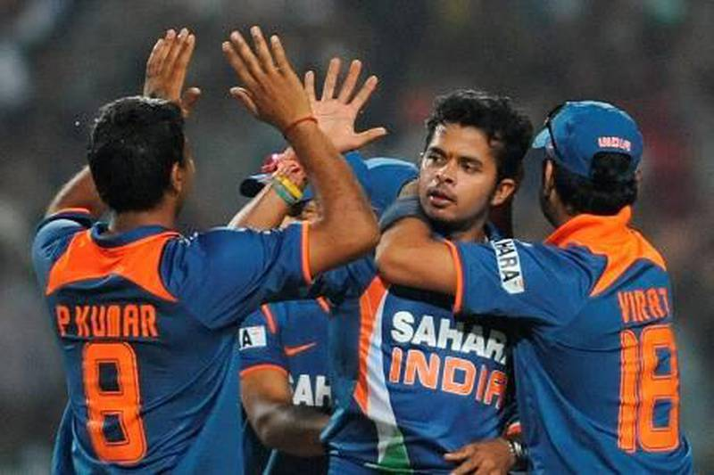 Indian cricketer Shanthakumaran Sreesanth celebrates with teammates after taking the wicket of unseen South African cricketer Roelof van der Merwe during the second One Day International (ODI) cricket match at the Captain Roop Singh Stadium in Gwalior on February 24, 2010. South Africa is currently 103 runs for the loss of six wickets chasing India's score of 401 runs.  FP PHOTO/ MANAN VATSYAYANA *** Local Caption ***  942708-01-08.jpg