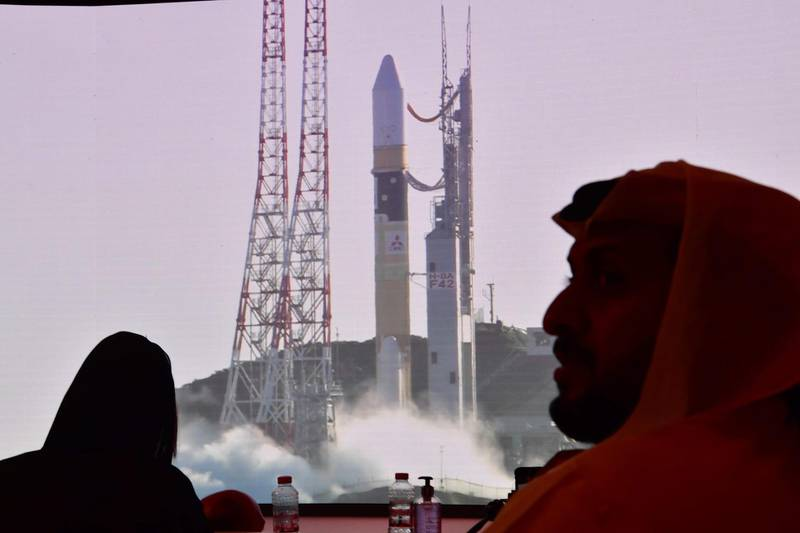 """A picture taken on July 19, 2020, shows a screen broadcasting the launch of the """"Hope"""" Mars probe at the Mohammed Bin Rashid Space Centre in Dubai. The probe is one of three racing to the Red Planet, with Chinese and US rockets also taking advantage of the Earth and Mars being unusually close: a mere hop of 55 million kilometres (34 million miles). """"Hope"""" -- Al-Amal in Arabic -- is expected to start orbiting Mars by February 2021, marking the 50th anniversary of the unification of the UAE. / AFP / Giuseppe CACACE"""