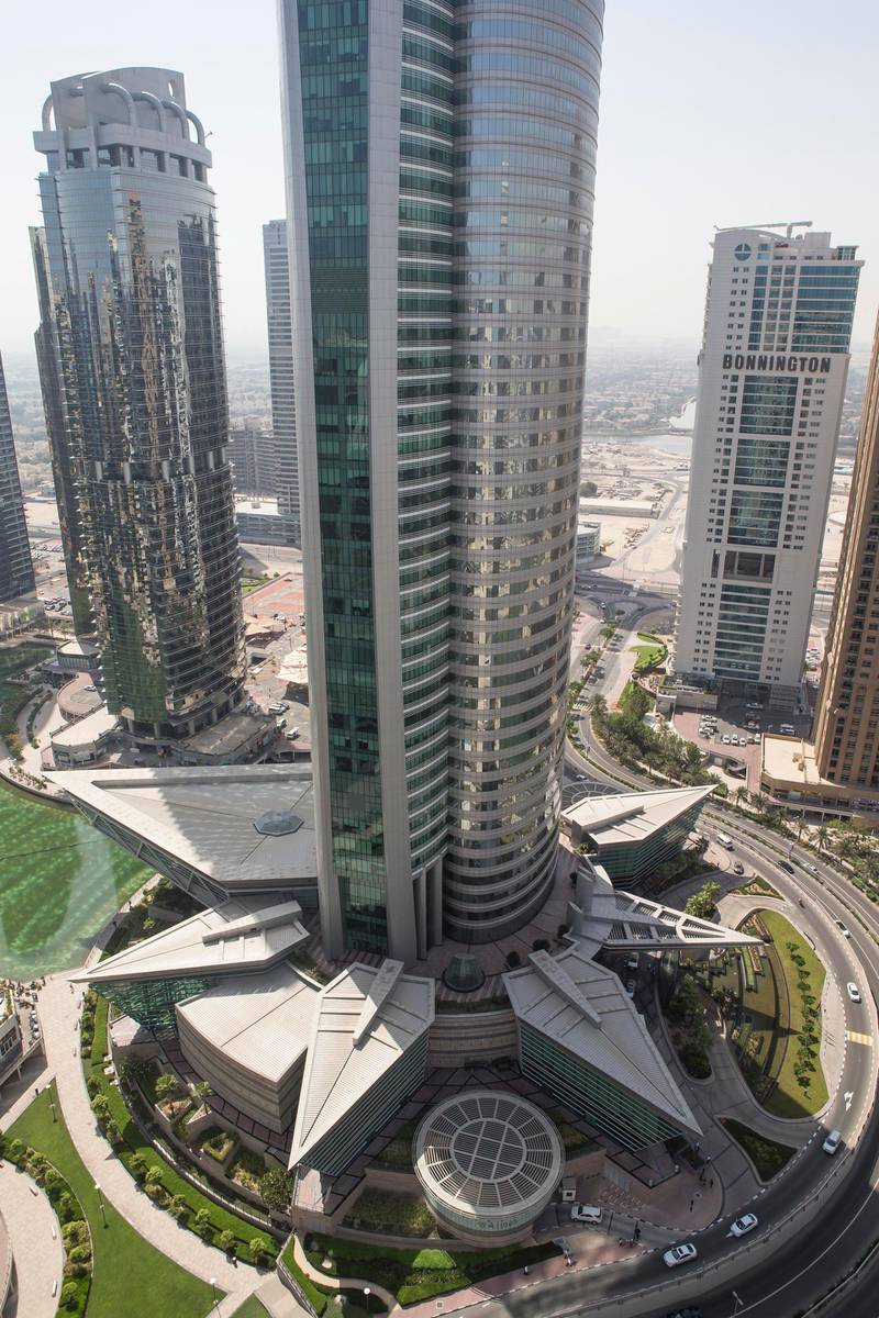 DUBAI, UNITED ARAB EMIRATES, 21  JUNE 2015. STOCK PHOTOGRAPHY of Almas Tower in Jumeirah Lakes, JLT. Apartments, Apartment, Rent, Rental, Dubai.  (Photo: Antonie Robertson/The National) Journalist: None. Section: National. *** Local Caption ***  AR_2106_Property_Stock-11.JPG