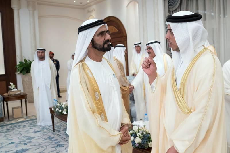 ABU DHABI, UNITED ARAB EMIRATES - August 21, 2018: HH Sheikh Mohamed bin Rashid Al Maktoum, Vice-President, Prime Minister of the UAE, Ruler of Dubai and Minister of Defence (L) and HH Sheikh Mansour bin Zayed Al Nahyan, UAE Deputy Prime Minister and Minister of Presidential Affairs (R) attend an Eid Al Adha reception at Mushrif Palace.  ( Mohamed Al Hammadi / Crown Prince Court - Abu Dhabi ) ---