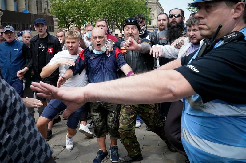 BOLTON, UNITED KINGDOM - JUNE 13: Black Lives Matter protesters counter demonstrators face off with each other at the Cenotaph during a Black Lives Matter protest on June 13, 2020 in Bolton, England. A number of anti-racism protesters have gathered for protests in the UK despite the cancellation of the official events due to fears of clashes with far-right groups. Following a social media post by the far-right activist known as Tommy Robinson, members of far-right linked groups have gathered around statues in London, which have been targeted by Black Lives Matter protesters for their links to racism and the slave trade. (Photo by Christopher Furlong/Getty Images)