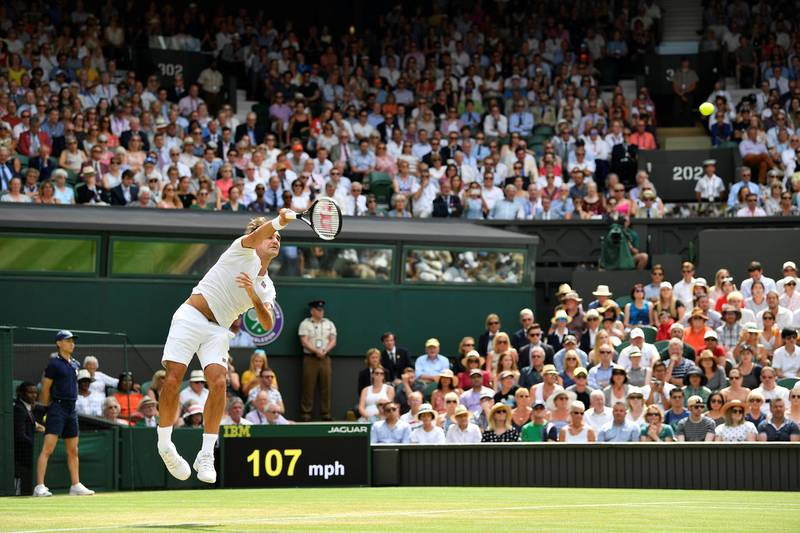 Tennis - Wimbledon - All England Lawn Tennis and Croquet Club, London, Britain - July 9, 2018. Switzerland's Roger Federer serves during his fourth round match against France's Adrian Mannarino.  REUTERS/Toby Melville