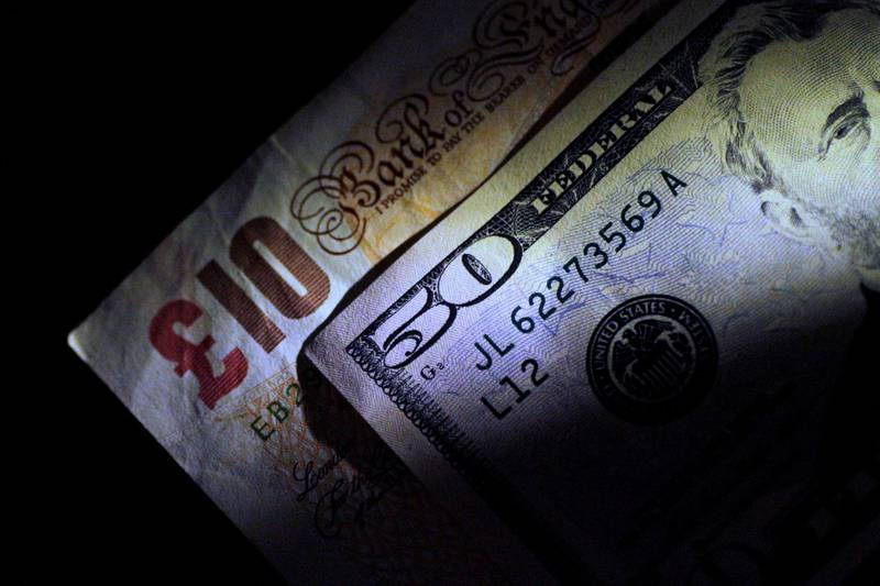 FILE PHOTO: British Pound Sterling and U.S. Dollar notes are seen in this June 22, 2017 illustration photo.   REUTERS/Thomas White/Illustration/File Photo