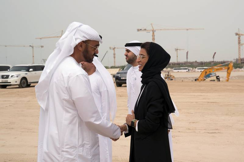 YAS ISLAND, ABU DHABI, UNITED ARAB EMIRATES - March 01, 2018: HH Sheikh Mohamed bin Zayed Al Nahyan, Crown Prince of Abu Dhabi and Deputy Supreme Commander of the UAE Armed Forces (L), greets HE Noura Mohamed Al Kaabi, UAE Minister of Culture and Knowledge Development (R), during the inspection of the urban development and tourism projects, at Yas Bay. Seen with HH Sheikh Theyab bin Mohamed bin Zayed Al Nahyan, Chairman of the Department of Transport, and Abu Dhabi Executive Council Member (2nd R).  ( Mohamed Al Hammadi / Crown Prince Court - Abu Dhabi ) ---