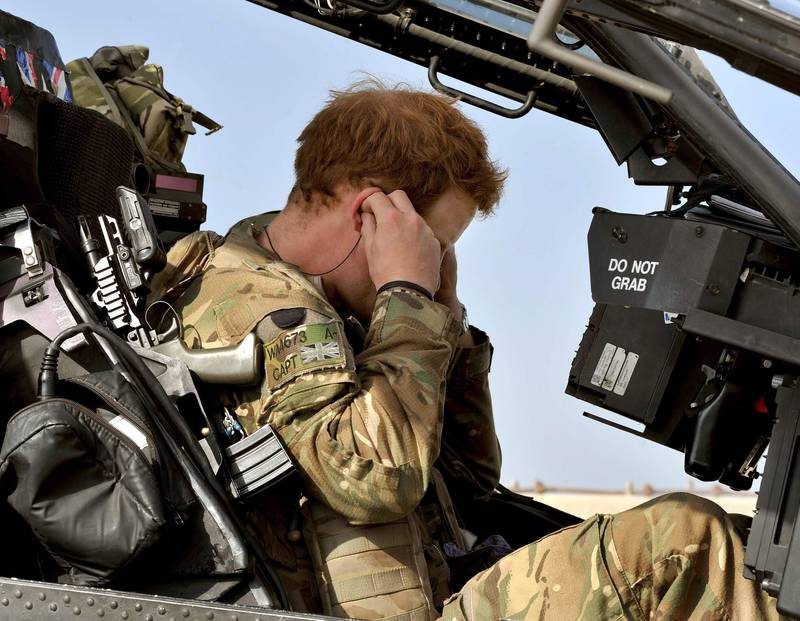 Britain's Prince Harry sits in his cockpit as he prepares for a mission, at the British controlled flight-line in Camp Bastion, southern Afghanistan in this photograph taken October 31, 2012, and released January 22, 2013. The Prince, who is serving as a pilot/gunner with 662 Squadron Army Air Corps, is on a posting to Afghanistan that runs from September 2012  to January 2013.  Photograph taken October 31, 2012.     REUTERS/John Stillwell/Pool  (AFGHANISTAN - Tags: MILITARY POLITICS SOCIETY ROYALS CONFLICT) *** Local Caption ***  LON007_BRITAIN-HARR_0122_11.JPG