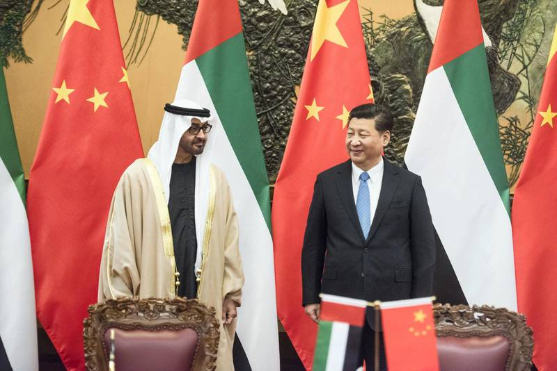 Sheikh Mohammed bin Zayed al-Nahyan (L), Crown Prince of Abu Dhabi and UAE's deputy commander-in-chief of the armed forces meets Chinese President Xi Jinping (R) during a signing ceremony at the Great Hall of the People in Beijing on December 14, 2015.  AFP PHOTO / POOL / FRED DUFOUR / AFP PHOTO / POOL / FRED DUFOUR